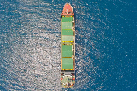 General cargo ship at sea - Aerial image