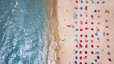 Tropical beach with colorful umbrellas - Top down aerial view Editorial