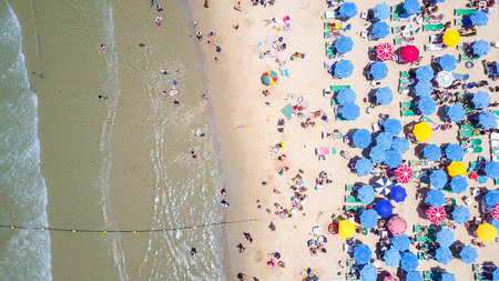 Tropical beach with colorful umbrellas - Aerial view