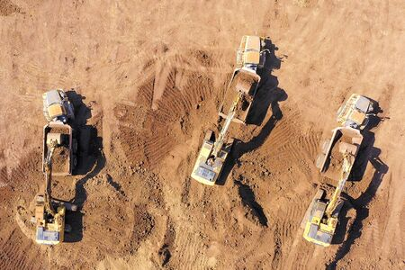 Excavators loading soil onto an Articulated hauler Truck.