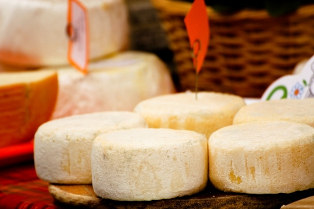 market stall: Cheese on a market stall Stock Photo