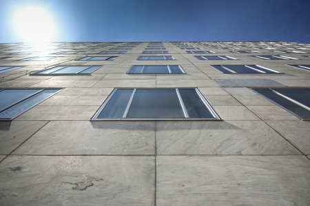 building feature: Building with marble facade and blue window Stock Photo