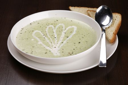 brocolli: bowl of brocolli soup on table