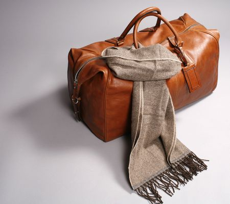 brown leathe bag with scarf on grey background Stock Photo