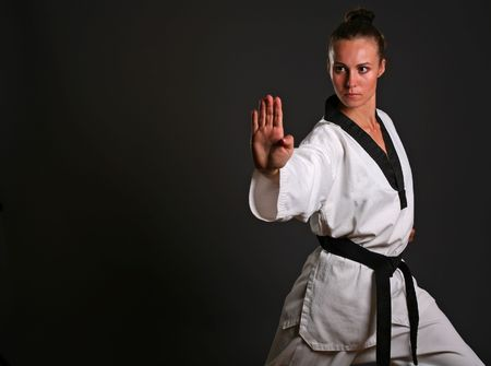 martial arts woman: girl in white kimono ready to fight