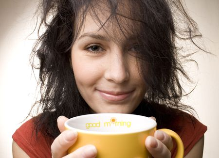 titled: positive girl with yellow cup titled Good morning