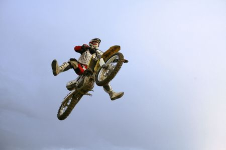 the motocross rider jumping over photographer