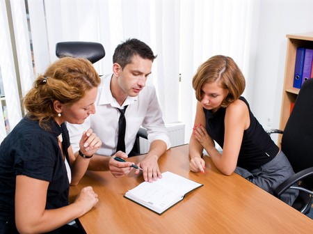 Manager with office workers on meeting in board room Hi Res
