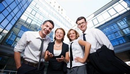 Happy office workers stay across building photo