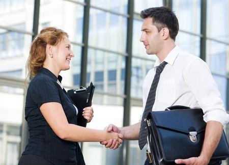Handshake between office workers outdoor photo
