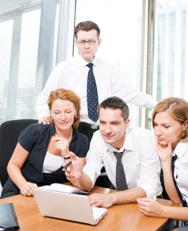 Manager with office workers on meeting in board room Hi Res photo