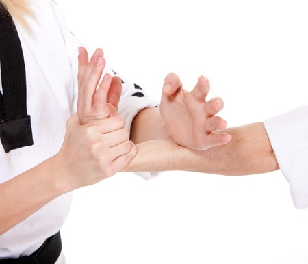 Hold hands of two fighting people on white background photo