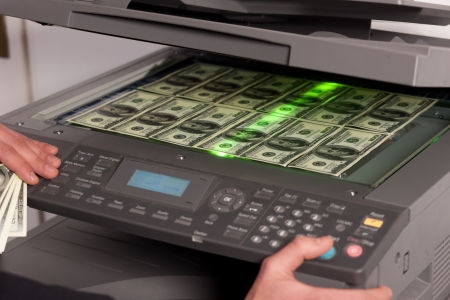 fake money: Close up of fake money on copy machine in office