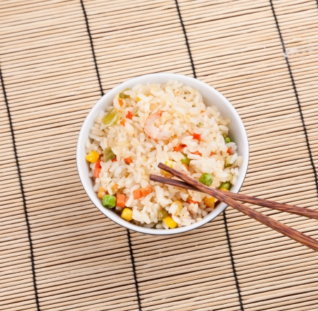 Fried rice dish with vegetables and prawn photo