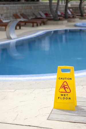 Caution about wet floor near pool