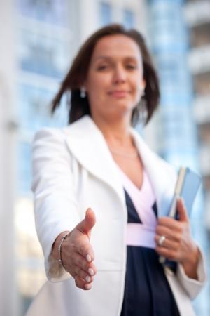 Beautiful businesswoman ready for handshake Stock Photo - 19062965