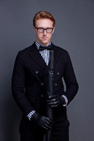 leather glove: elegant man wearing a bow and holding umbrella