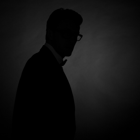 silhouette of man in a tuxedo on grey photo