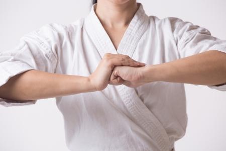 Woman in kimono going for greeting on white photo