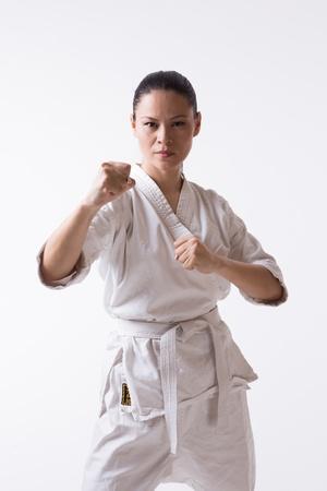 Asian woman in kimono show block in martial art exercise photo