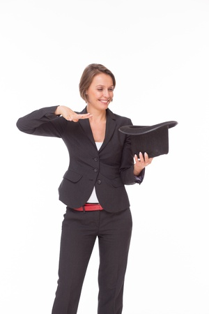 Business woman in suit show magic isolated on white photo