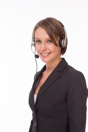 handsfree telephone: Business woman with headset isolated on white
