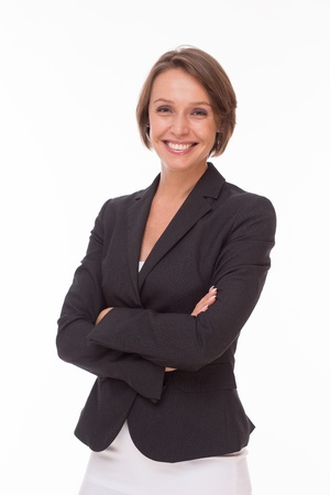 Positive businesswoman posing for camera isolated on white