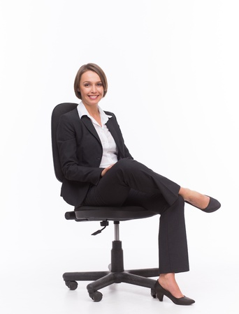 Businesswoman sit on chair isolated with white Stock Photo
