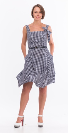 Beautiful woman in summer dress with gingham isolated on white