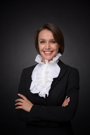 Beautiful business woman on dark grey background Stock Photo - 20902143