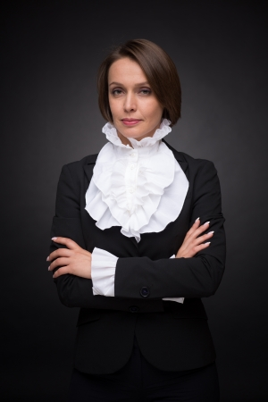 Beautiful business woman on dark grey background Stock Photo - 20902147