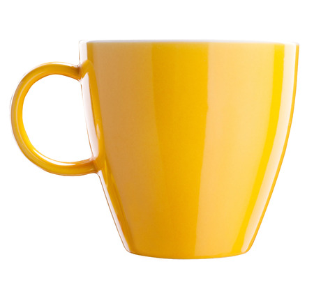 Close up of yellow tea cup isolated with clipping path on white 스톡 콘텐츠