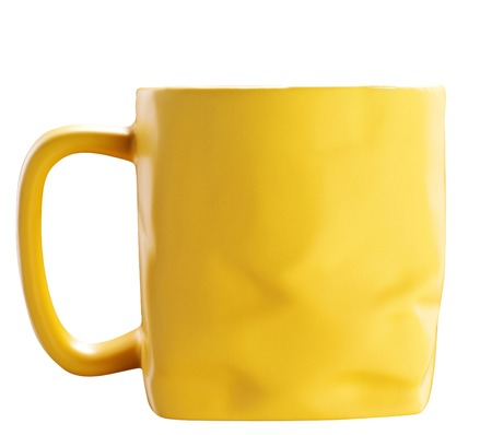 bruised: Yellow bruised ceramic tea cup isolated on white Stock Photo