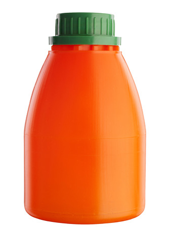 Orange plastic bottle for fresh juice isolated on white photo