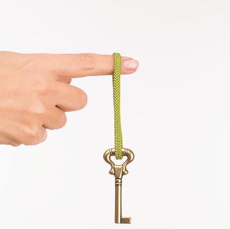 Hand hold old key isolated on white photo