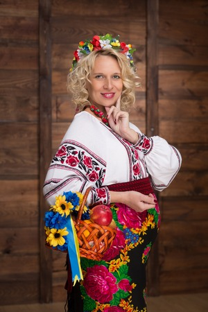Ukrainian pregnant woman in traditional embroidered shirt photo