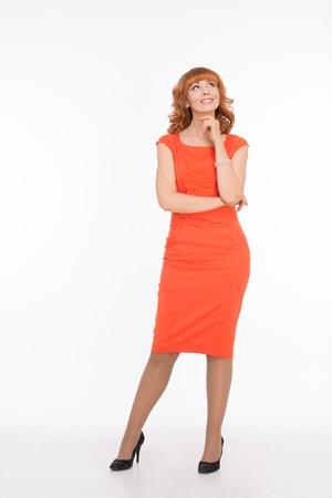 Beautiful woman in orange dress on white