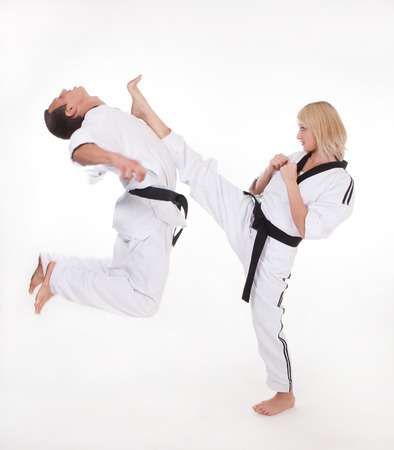 martial arts woman: Master show upper kick to head in close fight
