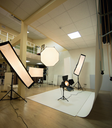 lighting background: Lighting set up in photostudio with wooden background