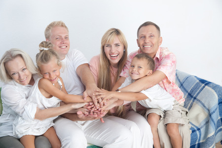 Happy family show love and unity with gesture holding hands together. Stock Photo