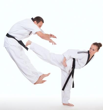 Woman in kimono strikes attacker with foot on white 스톡 콘텐츠