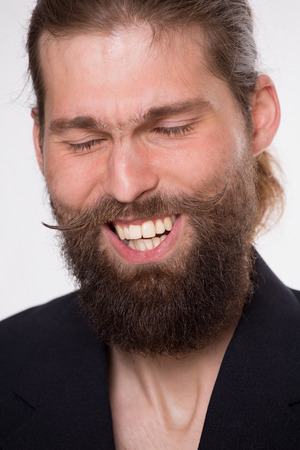 sincerely: Man with beard laugh sincerely on white background Stock Photo