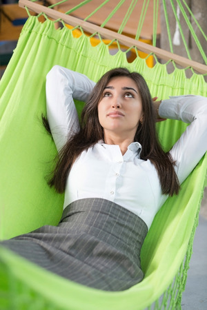 Beautifil woman rest in green hammock indoor photo