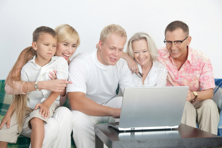 grand sons: Scandinavian family happy to be together to operate with computer Stock Photo