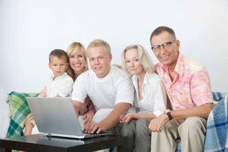 grand sons: European family with notebook sit in white room