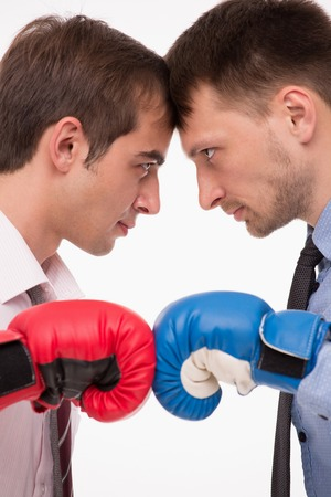 men standing: Two businessmen concerning with the scope of a business activities. Serious men standing face to face.