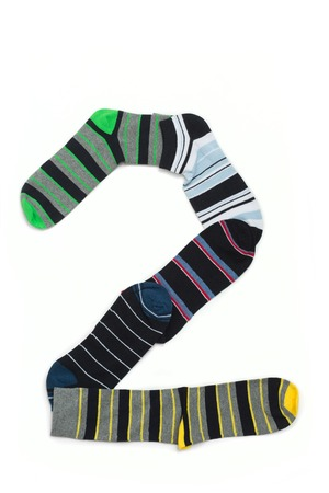 Number 2 made from all colours socks. Huge number 2 organized on white. photo