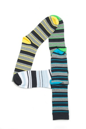 Number 4 made from light socks. All socks in lines isolated on white background. photo