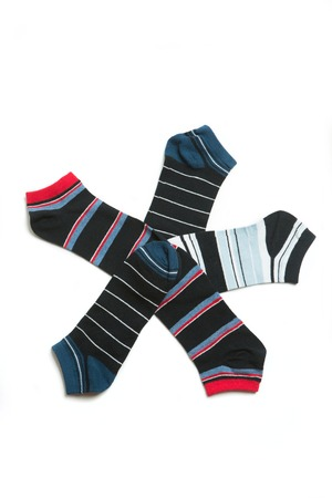 resembling: Many-coloured socks resembling conventional image of a star. Socks organized on white background.