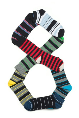 white socks: Many pairs of socks forming number eight. Socks with different colours on white background. Stock Photo
